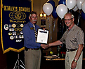 President Denny Mandeville presenting The Distinguished Service Award to Howard Olson